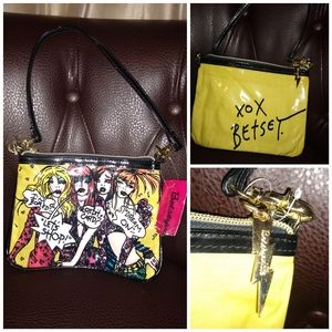 New with tag Betsy Johnson makeup bag or wristlet.